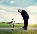 Boss looking at small meditation woman big women in the road Stock Photography