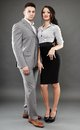 Boss and secretary couple full length studio portrait of over gray background Stock Photography