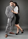 Boss and secretary couple full length studio portrait of over gray background Stock Photo