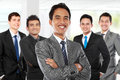 boss standing in front of his team, leading to success Royalty Free Stock Photo