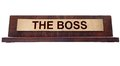 The boss wooden nameplate with text isolated on white Stock Photography