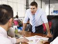 Boss yelling at subordinates bad tempered caucasian business executive two asian in office Royalty Free Stock Photo