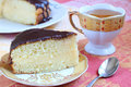 Boston cream pie and green tea on the table Stock Images