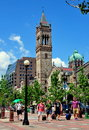 Boston ma old south church in copley square tourists walking with suitcases with the landmark neo romanesque the background Royalty Free Stock Image