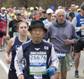 Boston marathon elderly athletes competing in the on their way from hopkinton to in massachusetts usa on april Royalty Free Stock Image