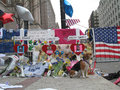 Boston marathon memorial three victims signs and flowers laid for the bombing on boylston and hereford to show solidarity and Royalty Free Stock Photo