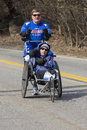 Boston marathon mobility impaired athlete competing at the on his way from hopkinton to in massachusetts usa on april Stock Photography