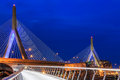 Boston s zacom bunker hill bridge at sunset on a cloudy spring evening shot from a footpath leading up to the bridge Royalty Free Stock Photography