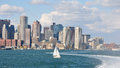 Boston skyline seen from boston harbor modern skyscrapers rising boat sailing in the atlantic ocean view Stock Photos
