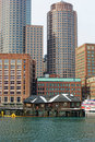 Boston skyscrapers above old fishing shacks Royalty Free Stock Photo