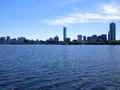 Boston summer skyline and river view during a warm sunnys day in the Stock Photos