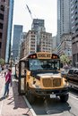 stock image of  BOSTON UNITED STATES 05.09.2017 - typical American yellow school bus drinving in the center of the city of Boston
