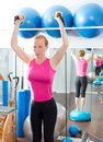 Bosu ball for fitness woman in aerobics gym Stock Photo