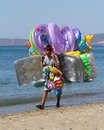 Bot offering balloons gumuldur september a young unidentified turkish boy natatorial gods at the beach on september gumuldur Royalty Free Stock Photos