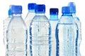 Botellas plásticas de agua mineral aisladas en blanco Fotos de archivo