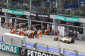 Force India cars waiting in queue to pit Royalty Free Stock Photo