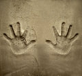 Both hands print on cement mortar wall Royalty Free Stock Photos