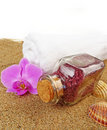 Bottle with  bath salt on beach sand background Royalty Free Stock Photo