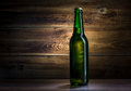 Bottle of beer on a wooden background Royalty Free Stock Photography