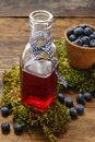 Bottle of blueberry juice and bowls of blueberries Royalty Free Stock Photo