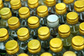 Bottle caps background rows of golden color with shallow depth of field Royalty Free Stock Images