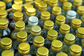 Bottle caps background rows of golden color with shallow depth of field Stock Photos