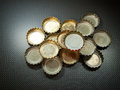 Bottle caps lot of on a gray background with pattern Royalty Free Stock Photos