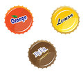 Bottle caps orange juice lemonade beer Royalty Free Stock Photography