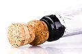 Bottle of champagne with cork over white background Stock Images