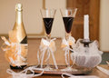 Bottle of champagne with glasses and candle Royalty Free Stock Photos