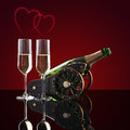 Bottle of champagne, two glasses and hearts Royalty Free Stock Photo