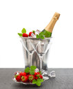 Bottle of champagne and two glasses over white bac Royalty Free Stock Photo