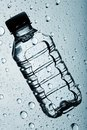 Bottle of clear purified water Stock Images