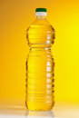 Bottle cooking oil yellow background Royalty Free Stock Image