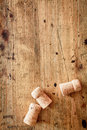 Bottle corks on a wooden background for champagne or wine with copyspace for your festive or new year greeting Royalty Free Stock Photo