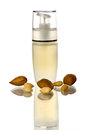 Bottle dispenser almonds oil white Royalty Free Stock Images