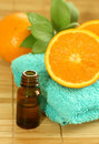 bottle of essence oil, towel and fresh oranges Royalty Free Stock Photo
