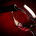 Bottle filling the glass of wine splash delicious flavor Royalty Free Stock Image