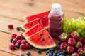 Bottle with fruit and berry juice or smoothie Royalty Free Stock Photo