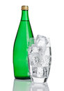 Bottle and glass with healthy sparkling  water Royalty Free Stock Photo