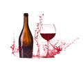 Bottle and glass with red wine, red wine splash, wine pouring on table isolated on white background, big splash around