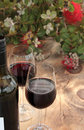 Bottle & Glasses Red Wine on Outdoor Table Royalty Free Stock Images
