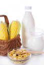 Bottle and jar of milk with corn and flakes isolated on white Stock Photo