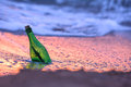 Bottle with letter in sea water Royalty Free Stock Images