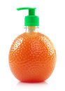 Bottle with liquid soap plastic in the shape of an orange on white background Royalty Free Stock Photos