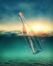 Bottle with a message in water Royalty Free Stock Photography