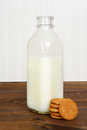 Bottle of milk with ginger snap cookies Royalty Free Stock Photo
