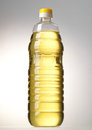 Bottle of oil on gray background Stock Photo