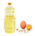 Bottle oil plastic big and egg Royalty Free Stock Photo