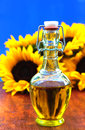 Bottle of oil with sunflowers Stock Photography